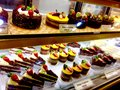 Tempting bakery fancy sweet chocolate cakes desserts mango cheesecake & fresh strawberries
