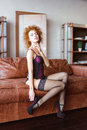 Tempting sensual woman in black lace stockings  relaxing on sofa Royalty Free Stock Photo