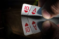 A ten and an ACE of spade in the hands Royalty Free Stock Photo