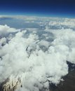 Ten kilometers high over clouds flying syria looking through window aircraft Royalty Free Stock Images