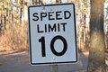 Ten miles per hour speed limit sign mph Stock Photography
