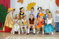Ten small children and adult woman dressed in carnival costumes Royalty Free Stock Photo