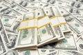 Ten thousand  dollar stacks on money background Stock Photo