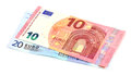 Ten and twenty euros on a white background Royalty Free Stock Photo