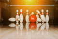 Ten white pins in a bowling alley with ball hit Royalty Free Stock Photo