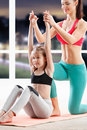 Ten years girl strething at fitness class Royalty Free Stock Photo