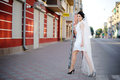 Tender brunnette young bride walking street in the morning Stock Images