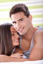Tender couple in bed young relaxing Royalty Free Stock Photography