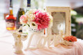 Tender decor of a table with lettering 'love', pink and white fl Royalty Free Stock Photo