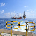 Tender drilling oil rig barge oil rig on the production platfo platform view from boat Stock Photo