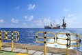 Tender drilling oil rig barge oil rig on the production platform view from crew boat Royalty Free Stock Photos