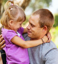 Tender hugs daughter her father Stock Photography