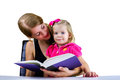 Tender moments mother reading a book to her daughter Royalty Free Stock Images