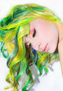 A tender portrait of a dreamy girl with colorful hair and make up have closed eyes Stock Images
