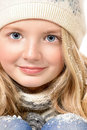 Tender portrait of a pretty ten years girl in warm clothes smiling at camera isolated over white Stock Photo