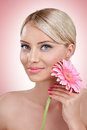 Tender woman with pink flower young beautiful posing Stock Photography