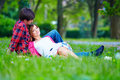 Tender young couple relaxing on spring meadow beautiful Stock Photos