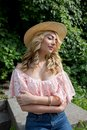 Tender young lady wearing straw hat and lace blouse with naked s Royalty Free Stock Photo