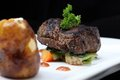 Tenderloin steak portion with potato on black background Stock Photography