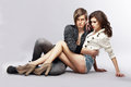 Tenderness couple of young stylish people embracing affection two sensual in embrace sitting Royalty Free Stock Images