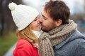Tenderness image of affectionate couple kissing outside Royalty Free Stock Images