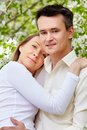 Tenderness portrait of young couple looking at camera in park Stock Photo