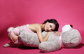 Tenderness sentiment daydreaming woman with teddy bear laying happiness lovely dreamy and Royalty Free Stock Images
