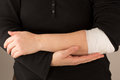 Tendinitis bodypart showing arms holding a bandaged arm Stock Photography