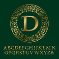 Tendrils gold letters with D initial monogram. Baroque font