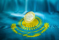 Tenge kazakh money coin hundred on the table the surface of the table the flag of kazakhstan coin is an edge Stock Image
