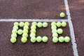 Tennis ace serve created using balls on a hard court surface Royalty Free Stock Image