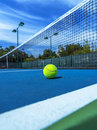 Tennis Ball on Blue Court, Doubles Sideline and Net Royalty Free Stock Photo