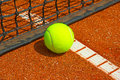 Tennis ball bright yellow on the court Royalty Free Stock Images