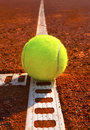 Tennis ball on a court Stock Photography