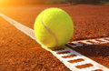 Tennis ball on a court Royalty Free Stock Photos