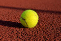 Tennis ball in a court useful for background designs Stock Image