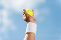 Tennis ball in his hand. Royalty Free Stock Photo