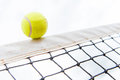 Tennis ball hiting the net hitting isolated over white Stock Images