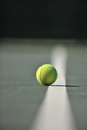 Tennis ball on the line Royalty Free Stock Photos