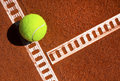 Tennis ball photo of a on a court Royalty Free Stock Images