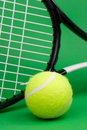 Tennis ball with racket Stock Image