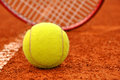 Tennis ball and racket on the court Royalty Free Stock Photo