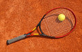 Tennis ball and racket on the court Stock Photos