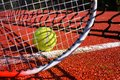 Tennis ball, racket and line on an outdoor court Royalty Free Stock Photo