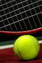 Tennis Ball and Sport Racket on a Court  Stock Photos
