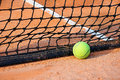 Tennis ball on a tennis clay court Royalty Free Stock Photography