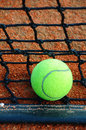Tennis ball on a tennis clay court Stock Photography