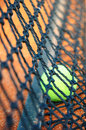 Tennis ball on a tennis clay court focus net Royalty Free Stock Image