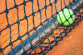 Tennis ball on a tennis clay court focus net Stock Images