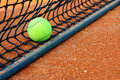 Tennis ball on a tennis court clay Stock Images